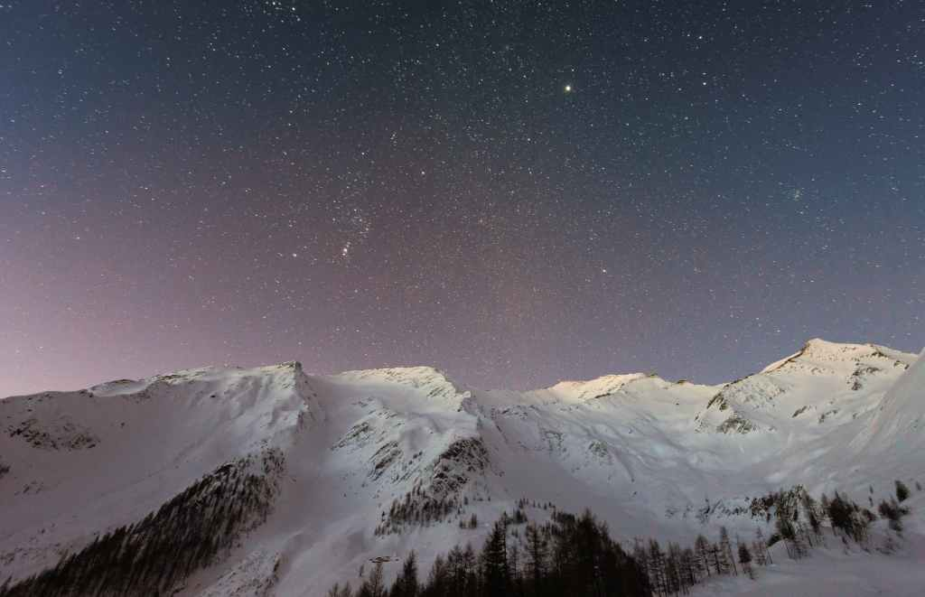 mountain covered snow under star