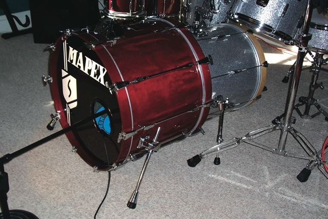 "Fig. 3 To create a drum-shell bass tunnel, a 22"" kick drum with ported resonant head is internally miked in front of an 18"" kick drum with an intact resonant head. The primary kick drum could be additionally miked with a boundary microphone."