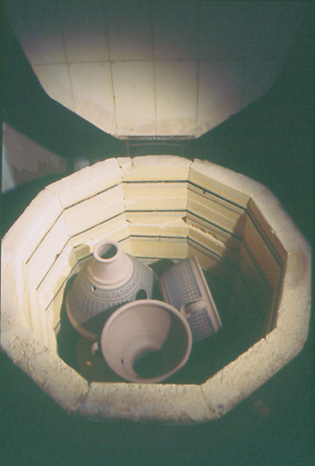 Fig. 14: The drums are fired in a kiln to strengthen the shells before glazing.