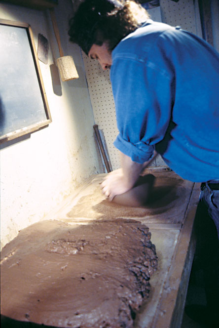Fig. 3: Wright works the clay until it is the proper consistency.