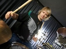 ray luzier with drum sticks