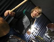 ray luzier with drum sticks