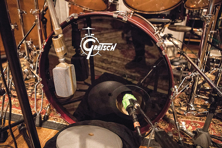 Engineer Tom Tapley used two microphones to pick up the bass drum: an AKG D 30 outside the batter head and a Sennheiser MD 421 placed through a port in the front head.
