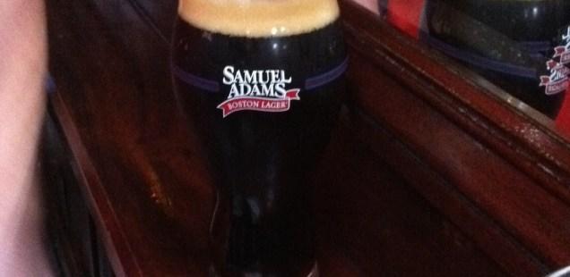 A pint of Samuel Adams Cherry Chocolate Bock in a specialty Samuel Adams glass