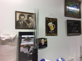 Pictures of the Odd Couple (Tony Randal and Jack Klugman), Ed Hahne, and old advertising signs from Lucky's Bar, the Glenlivet, and Irish Mist at Long Ireland Brewery