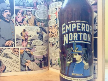 Photo of a bottle of Emperor Norton in front of a page from The Sandman featuring the real Norton