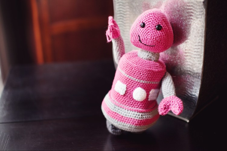 Crocheted robot plush in pink