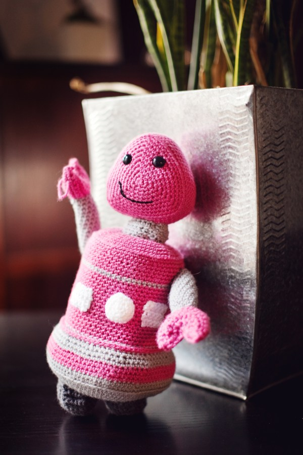 Crocheted pink robot plush