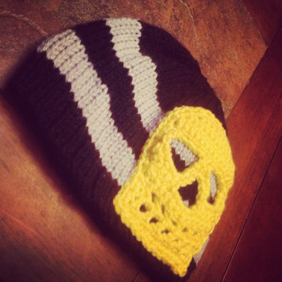 Knit and crochet beanie with skull