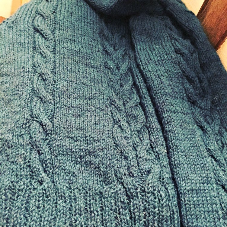 Handknit sweater with cables