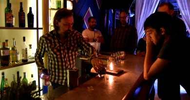 Bartender lighting cocktail on fire