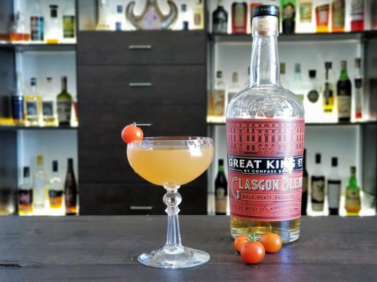 Cocktail with cherry tomato garnish