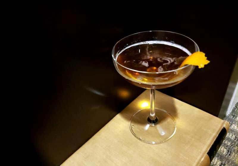 Cocktail with lemon twist garnish