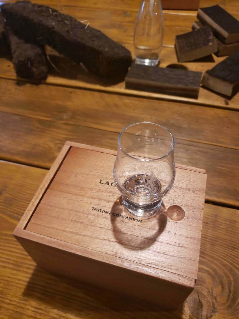 Wooden box with small glass on top