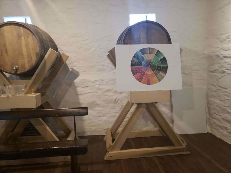Barrel with multi colored circle in front