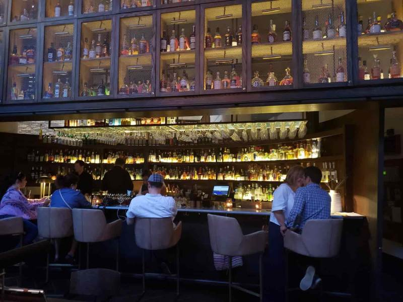 Bar with many bottles on top