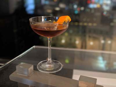 Cocktail with orange twist garnish