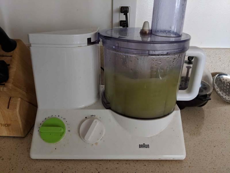 Food processor containing green liquid