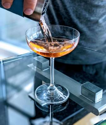 Cocktail being poured into glass