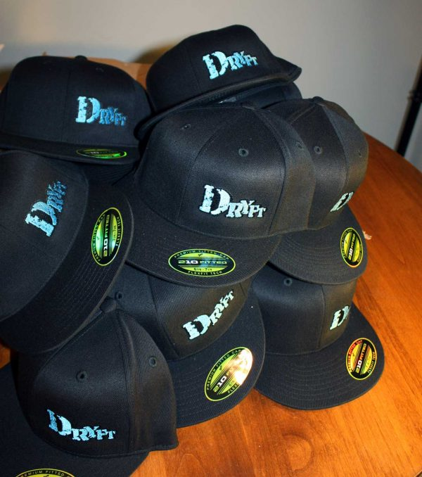 pile of DRYFT flat brim fishing hats