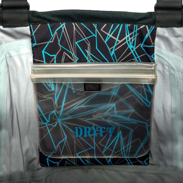 DRYFT S14 wader inside flip out pocket showing media pouch