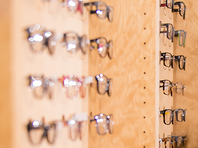 frameboard holding multiple pairs of eyeglasses in Tulsa
