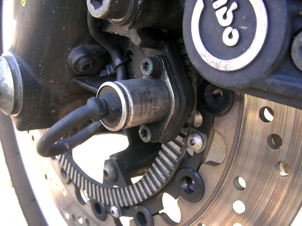 ABS sensors are attached to the wheels to monitor wheel speed.