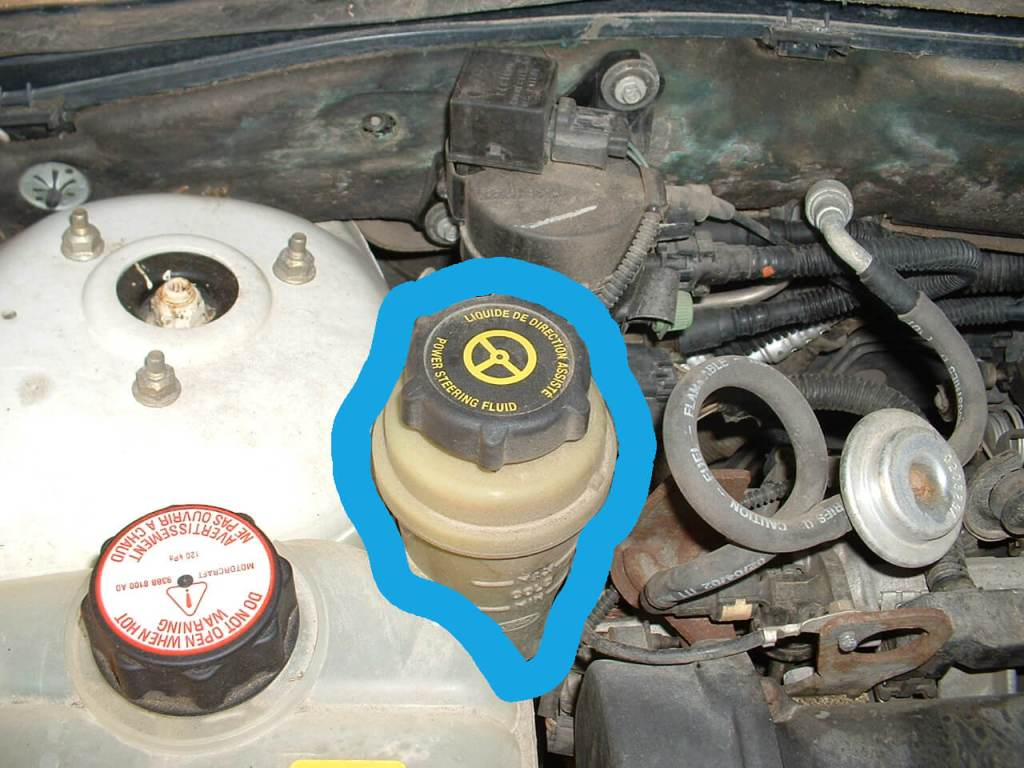 """If you lift your car hood, you should be able to find this yellow container that has the word """"Power Steering Fluid"""", """"MIN"""" and """"MAX"""" embedded on it."""