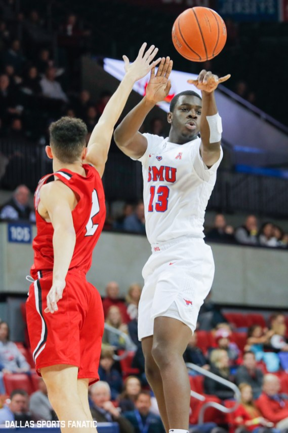SMU Sophomore CJ White makes a pass in traffic during the first half of the game between Southern Methodist University and Hartford on November 27, 2019 at Moody Coliseum in Dallas, Tx. (Photo by Joseph Barringhaus/Dallas Sports Fanatics)