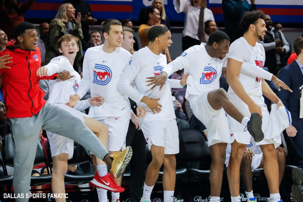 The SMU bench celebrates after an alley-oop is made during the second half of the game against Temple on January 18, 2020, at Moody Coliseum in Dallas, Tx. (Photo by Joseph Barringhaus/Dallas Sports Fanatic)