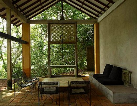 Verandah of the guesthouse at Lunuganga Garden Estate, garden developed by Geoffrey Bawa who lived between 1919 and 2003, Bentota, Sri Lanka, Asia