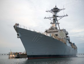 Navy warship at a pier