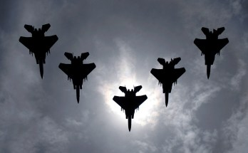 aircraft flying below an eclipse