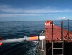 a missile hitting a barge floating in the ocean