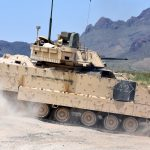 infantry fighting vehicle near the mountains