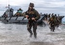 Marines runn out of an amphibious landing craft