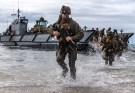 Marines runn out of an amphibious landing craft