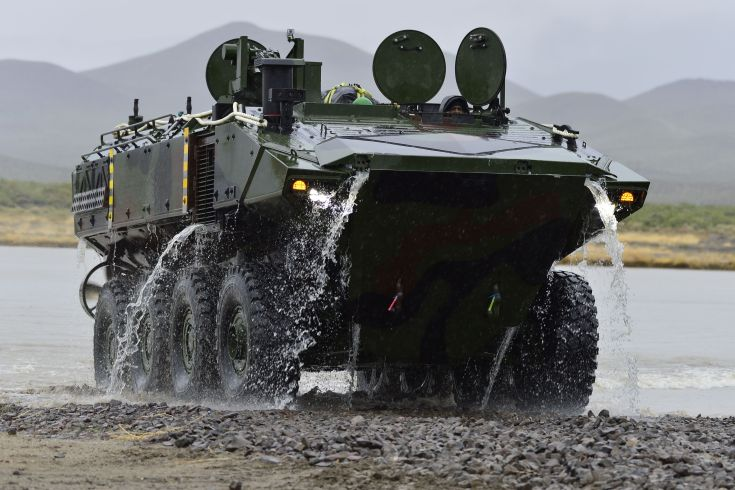 amphibious vehicle drives out of the water