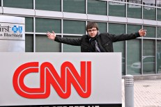 Richard posing with CNN sign