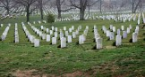 Granite headstones solemnly mark the final resting places of individuals who have given their lives for their country.