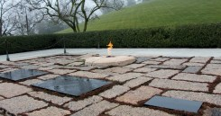 The graves of John F. Kennedy, his wife, and two of their children lie near the Eternal Flame.