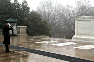The commander of the Guards of Honor salutes the Tomb of the Unknowns during the Changing of the Guards ceremony.