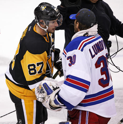 Pittsburgh Penguins' Sidney Crosby (87) shakes hands with New York Rangers goalie Henrik Lundqvist (30) after game 5 of a first-round NHL playoff hockey game in Pittsburgh, Saturday, April 23, 2016. The Penguins won 6-3, to clinch the best-of-seven games series 4-1. (AP Photo/Gene J. Puskar)