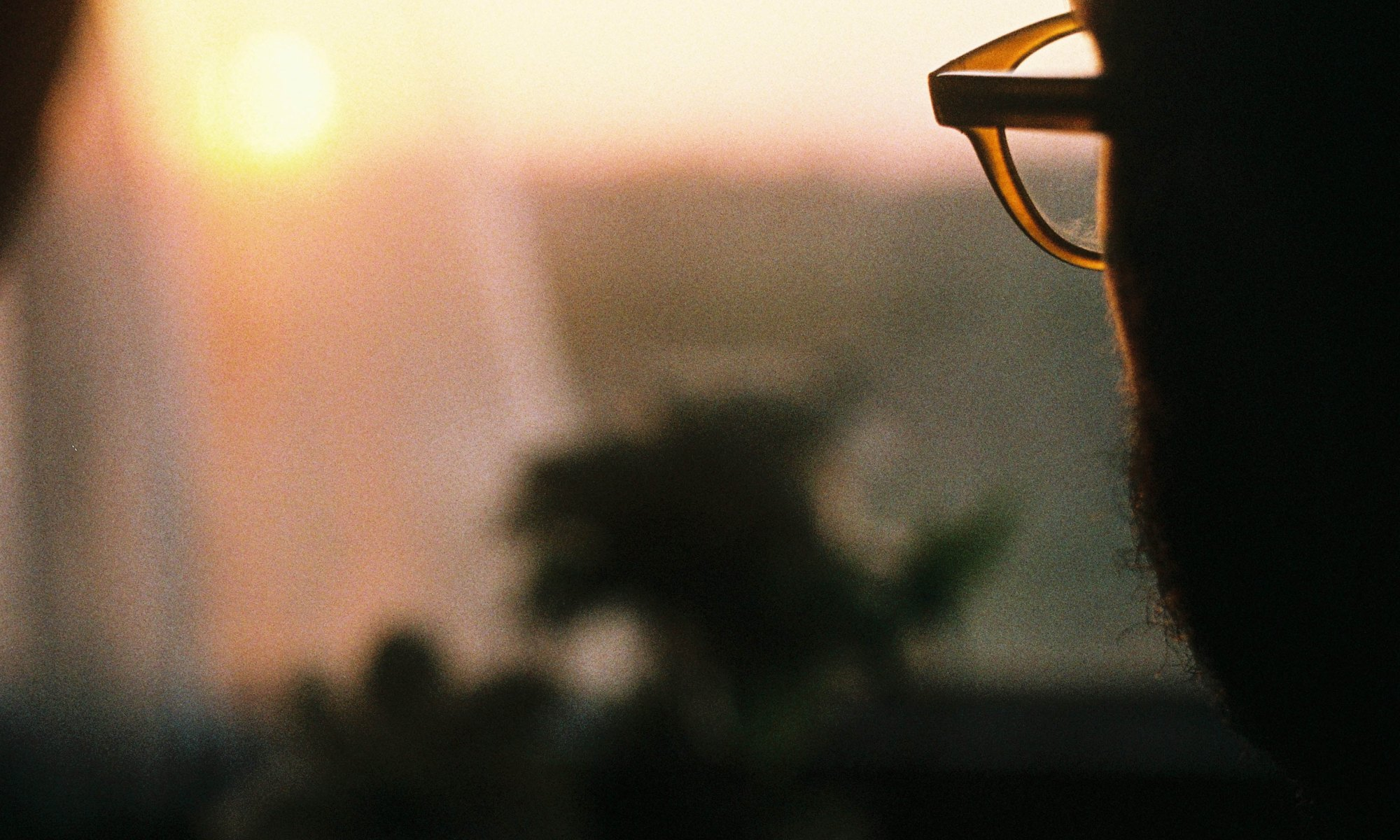 Man with eyeglasses loosening his mind and staring into the distance