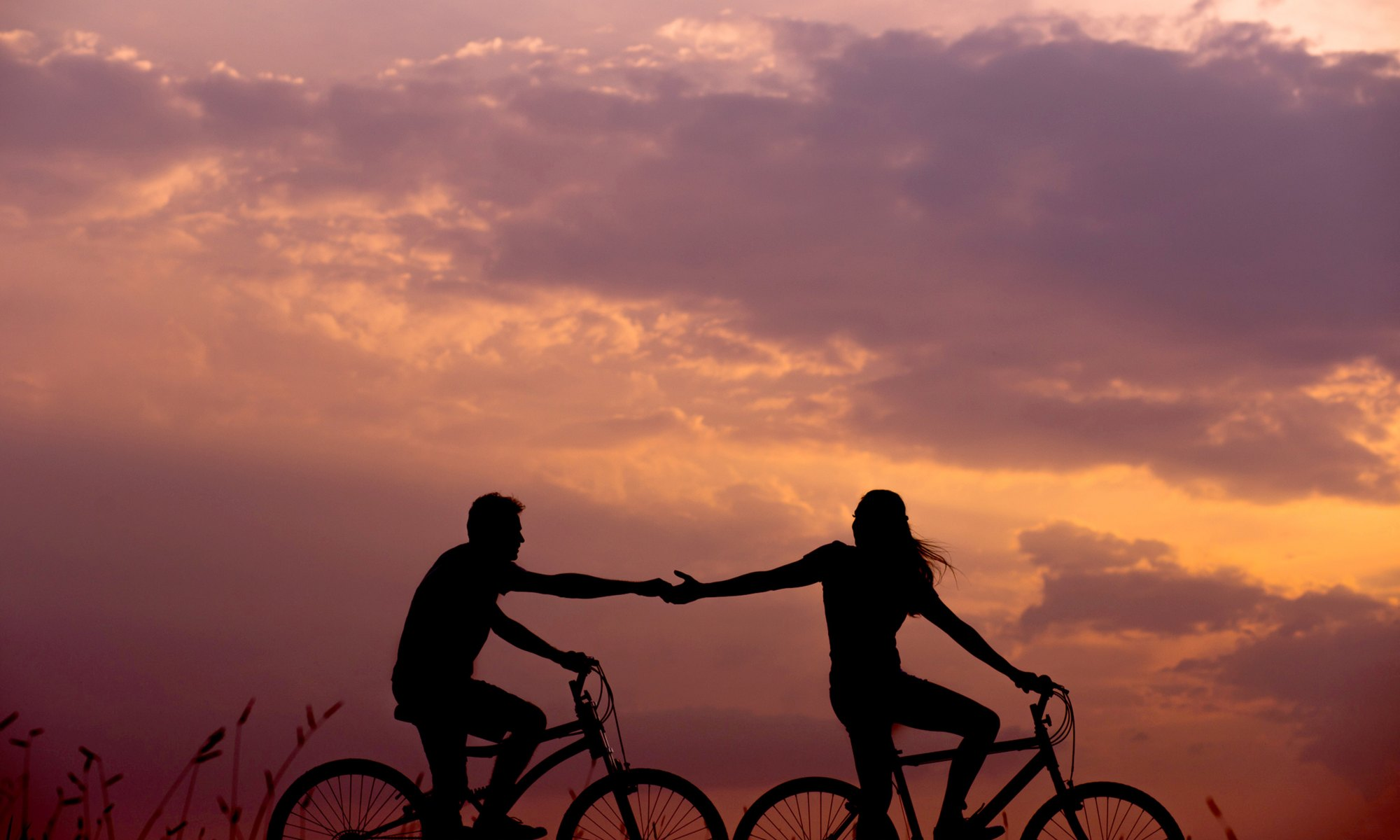 Man and woman in a sexless relationship riding bikes together
