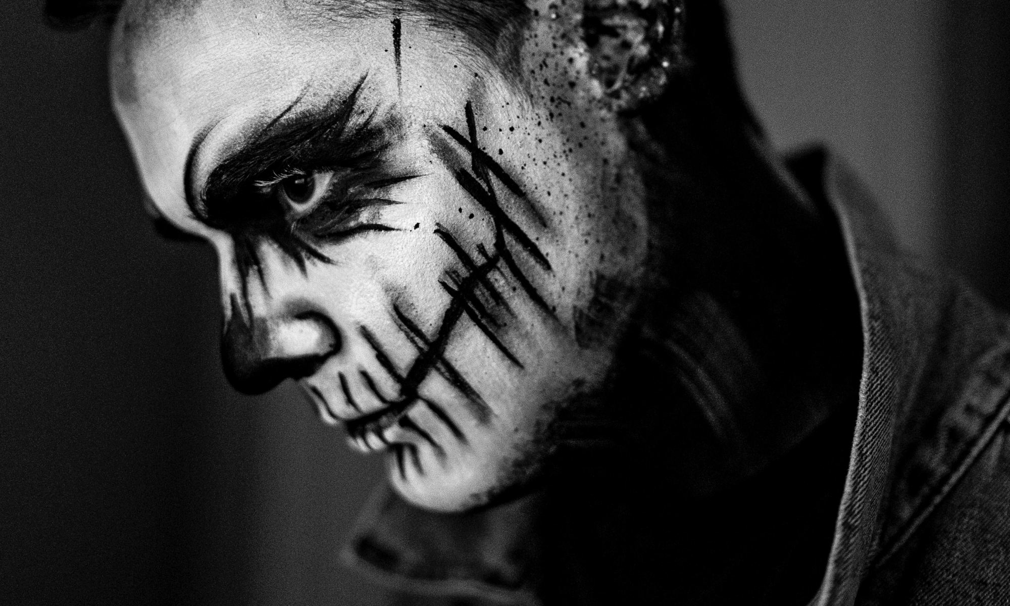 Sociopathic man with painted face