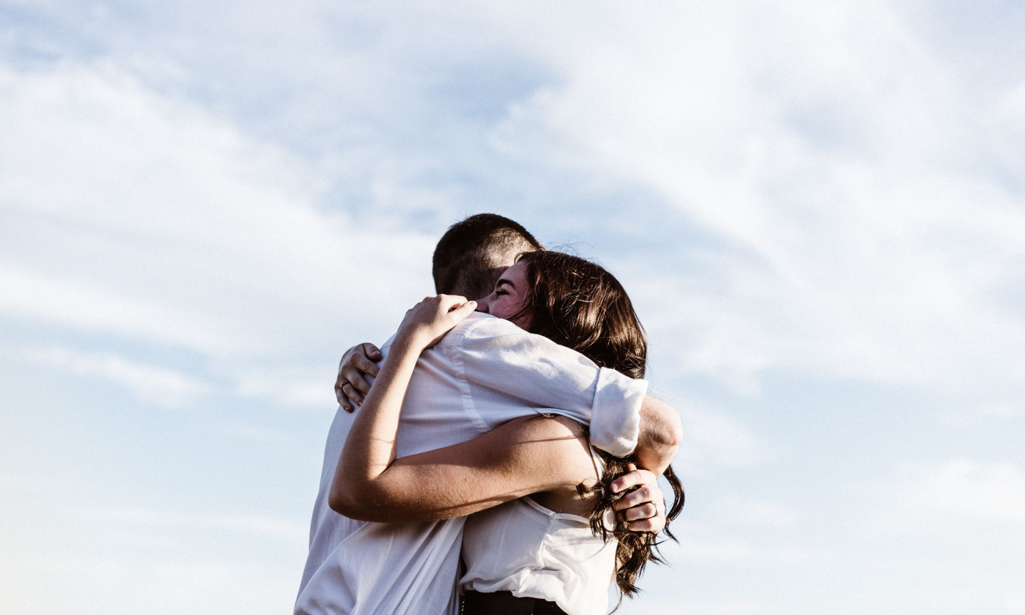 Man and woman hugging and showing empathy for each other
