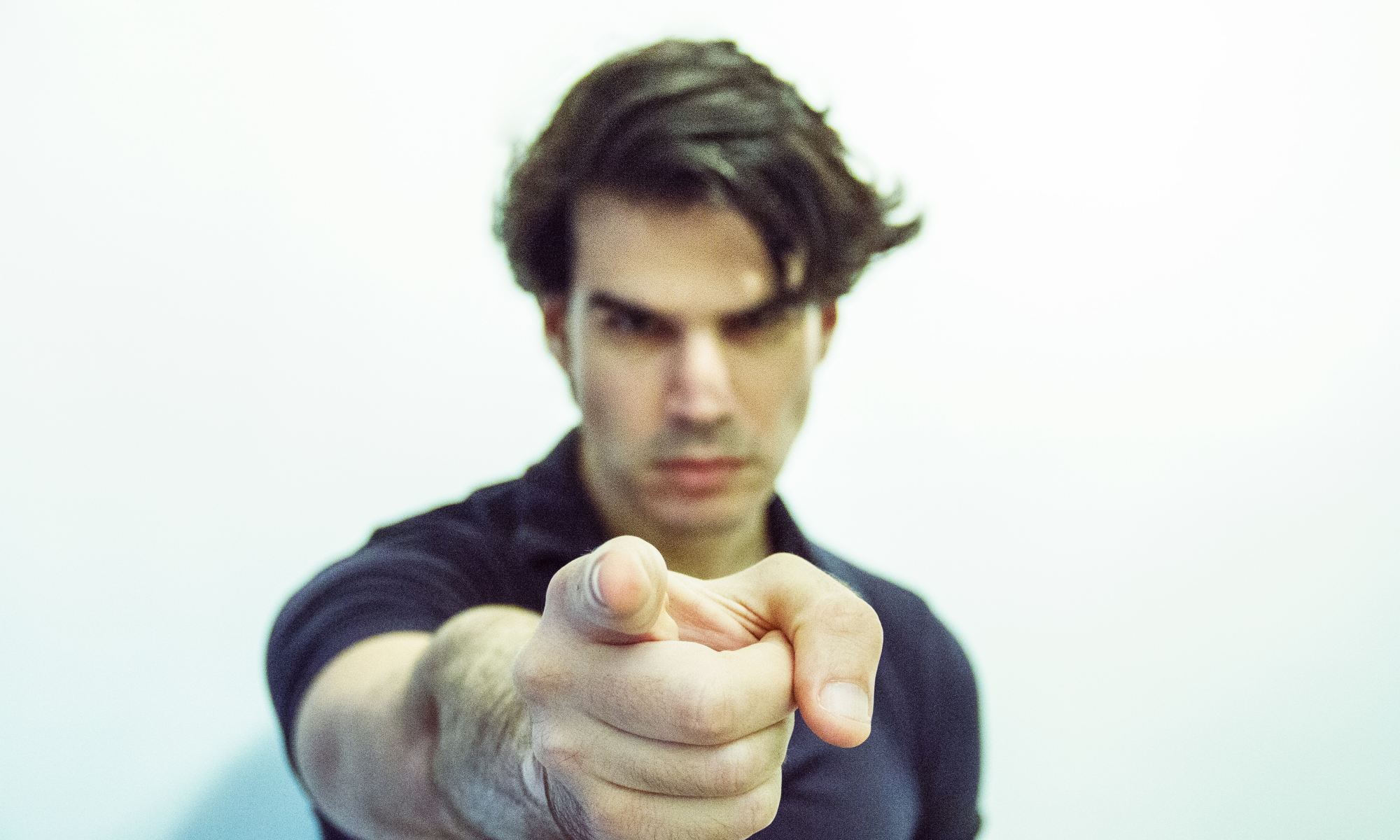 Man blaming someone else by pointing finger at them