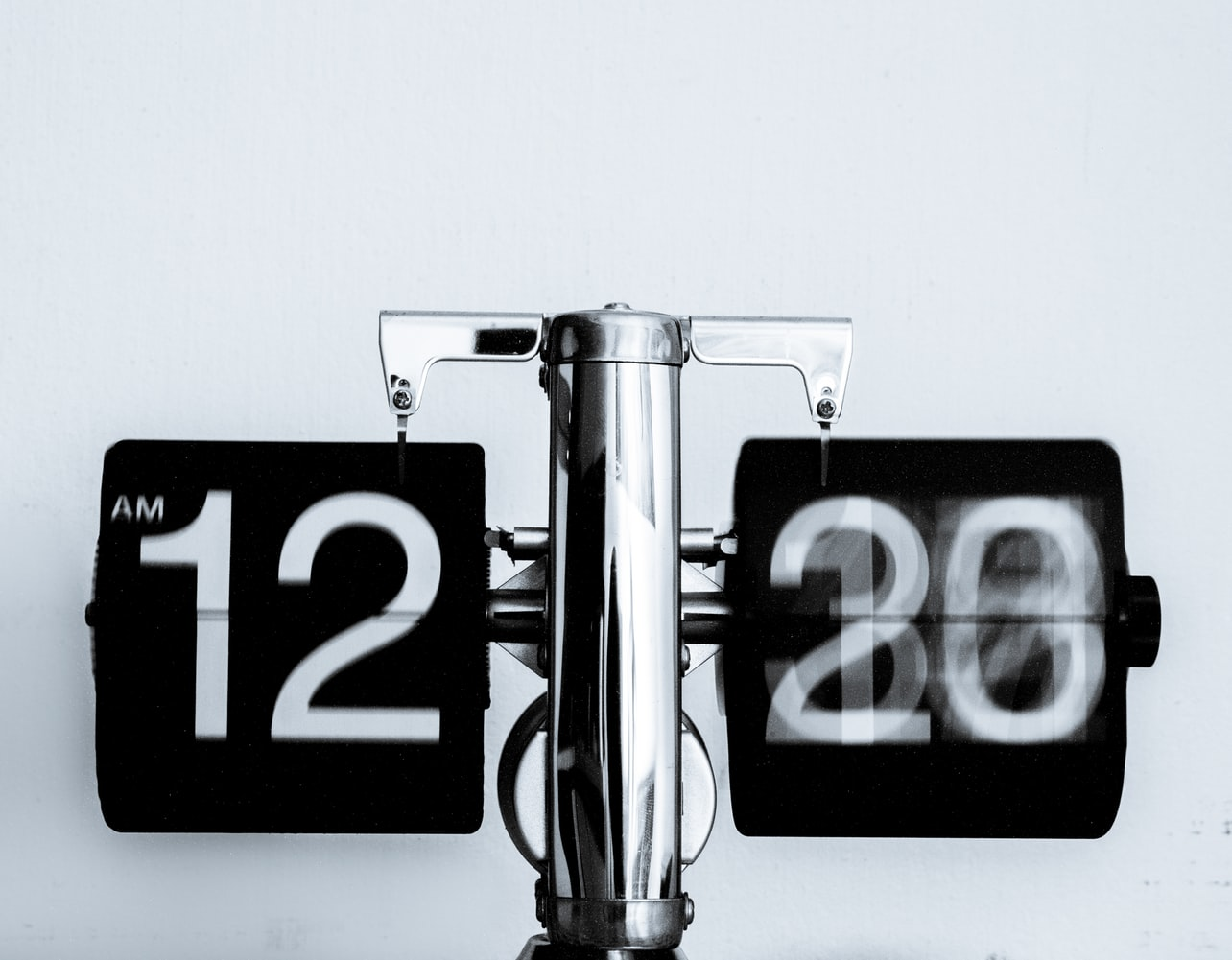 Black and white analog clock showing 12 a.m.