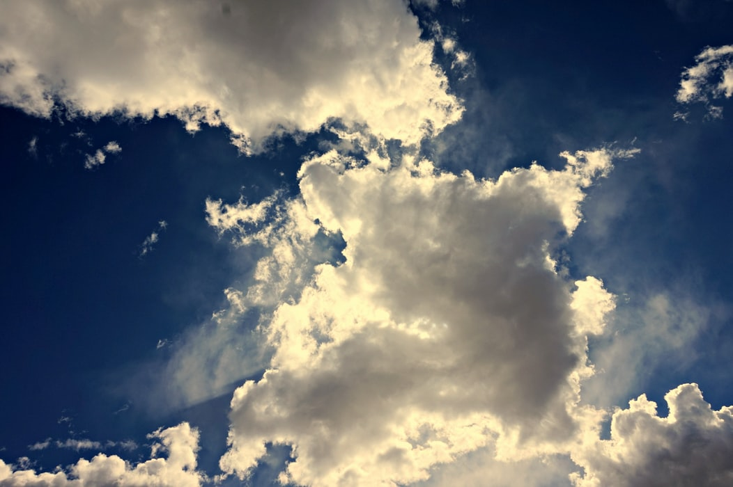 Ground view of white clouds in sky